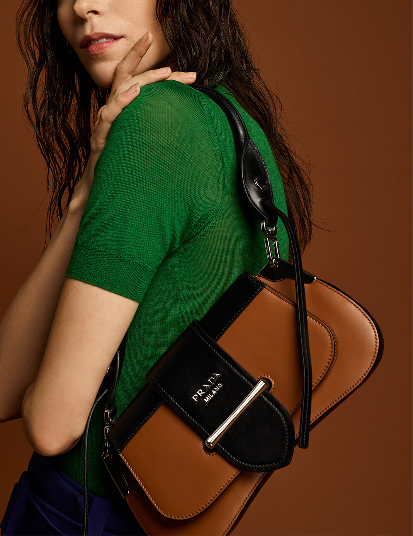 Prada model with brown bag
