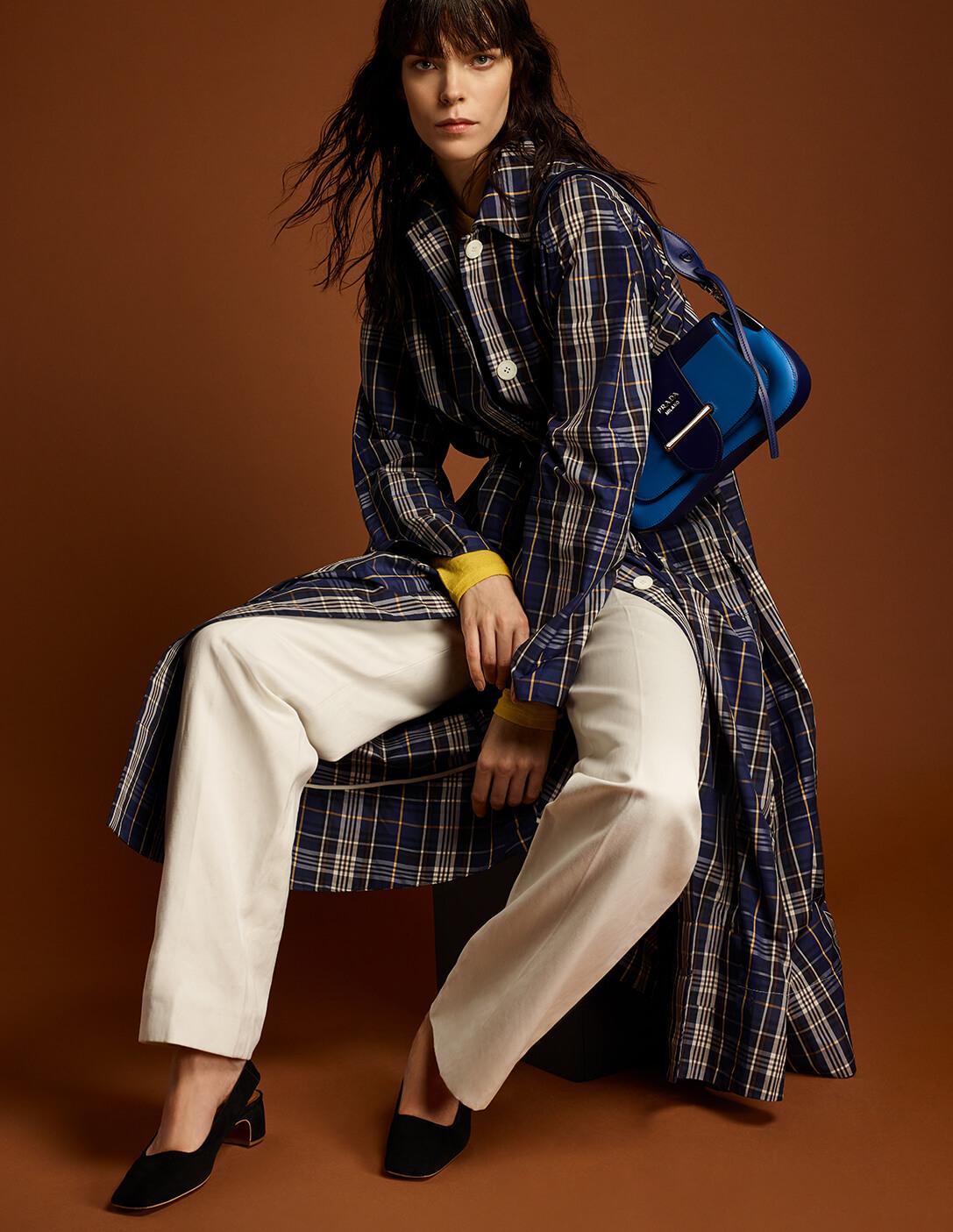 Prada model with plaid coat