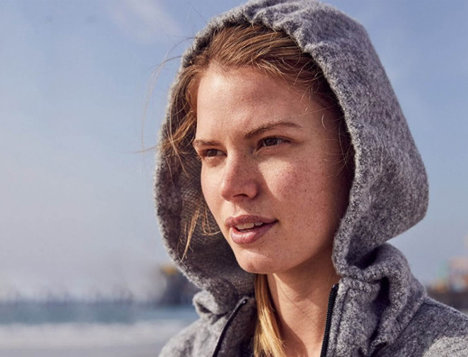 close up shot of a woman in a grey hoodie jacket