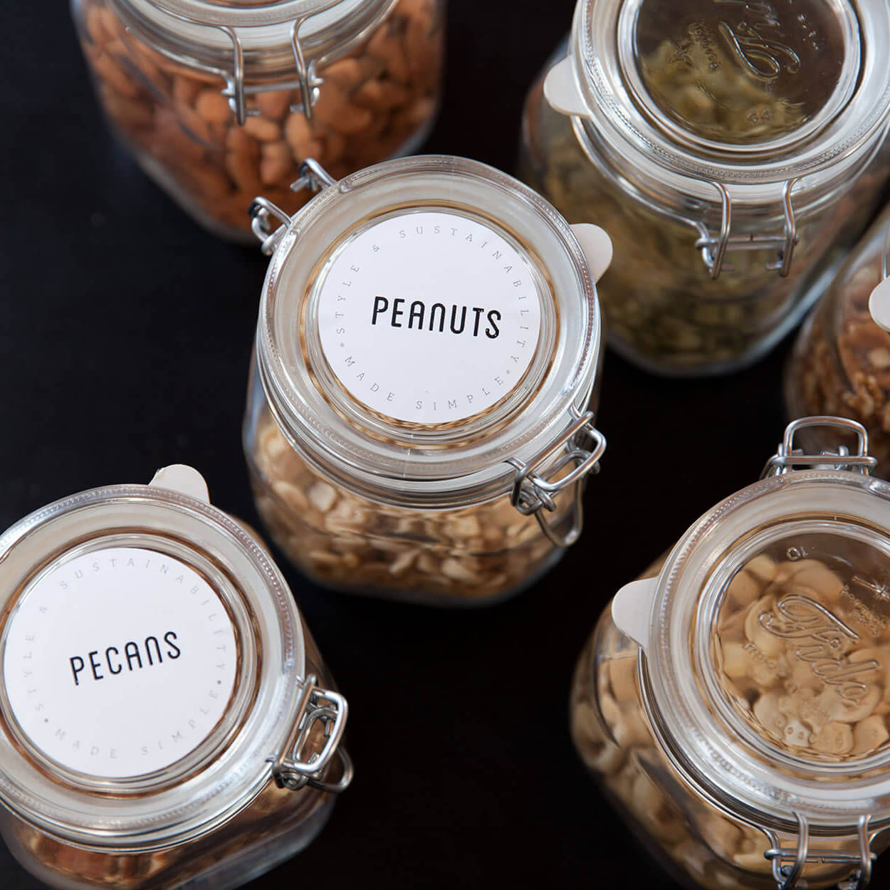 various foods inside jars with labeled lids