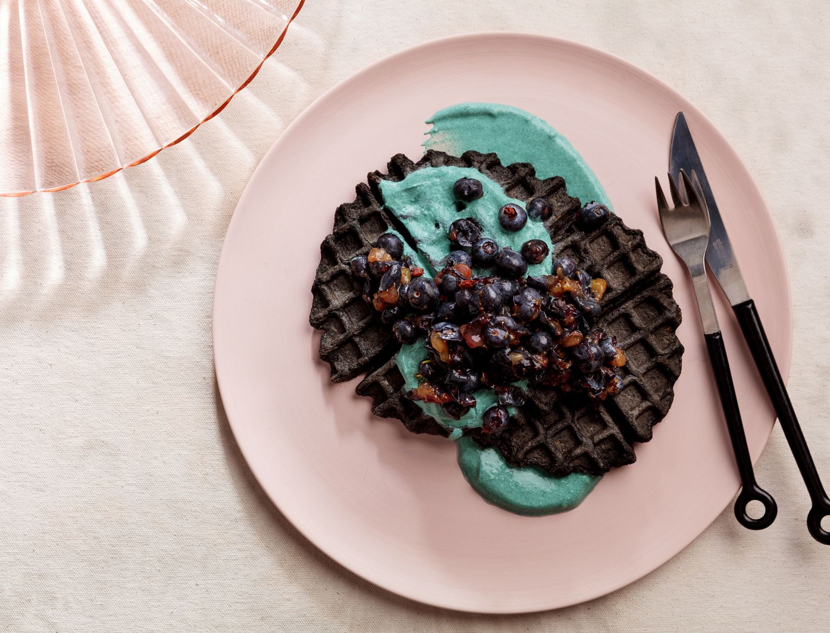 Charcoal Oat Waffles with Blueberries and Coconut Yogurt