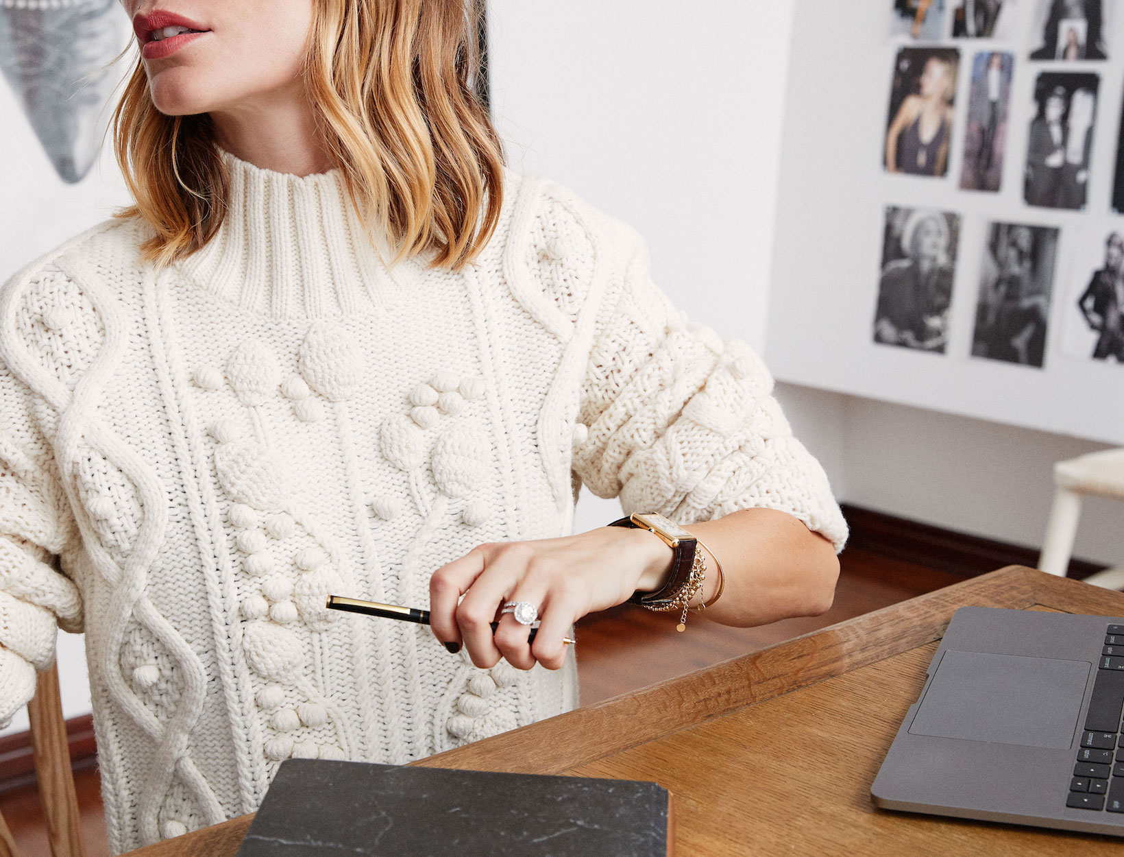 Woman in white sweater working at computer