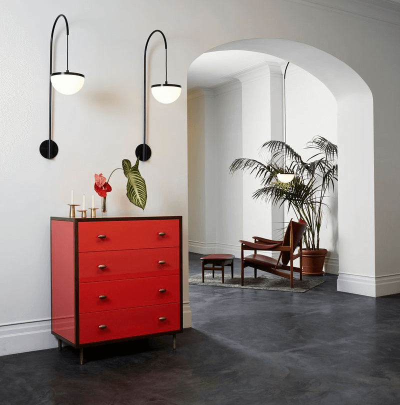 Pendant Lights Hanging Over Red Dresser