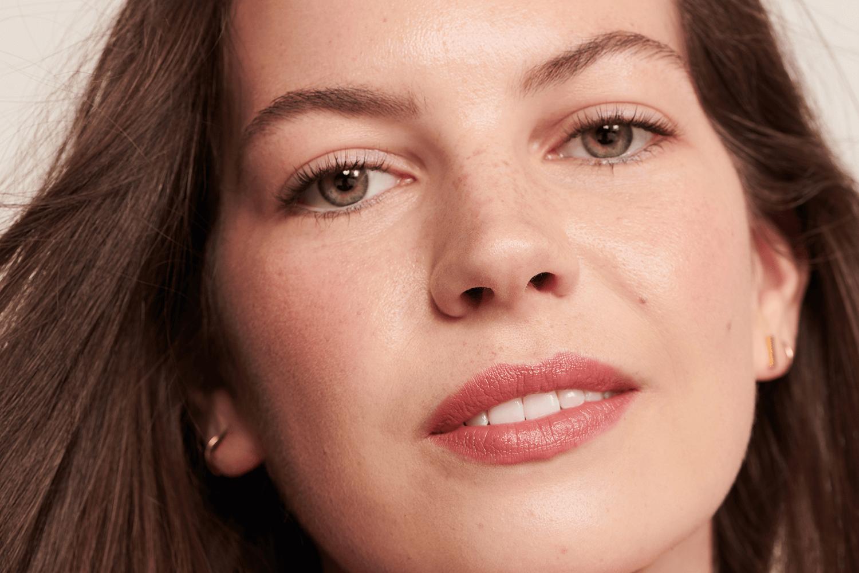 Model wearing pink lipstick