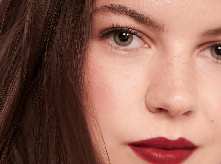 Model wearing dark red lipstick