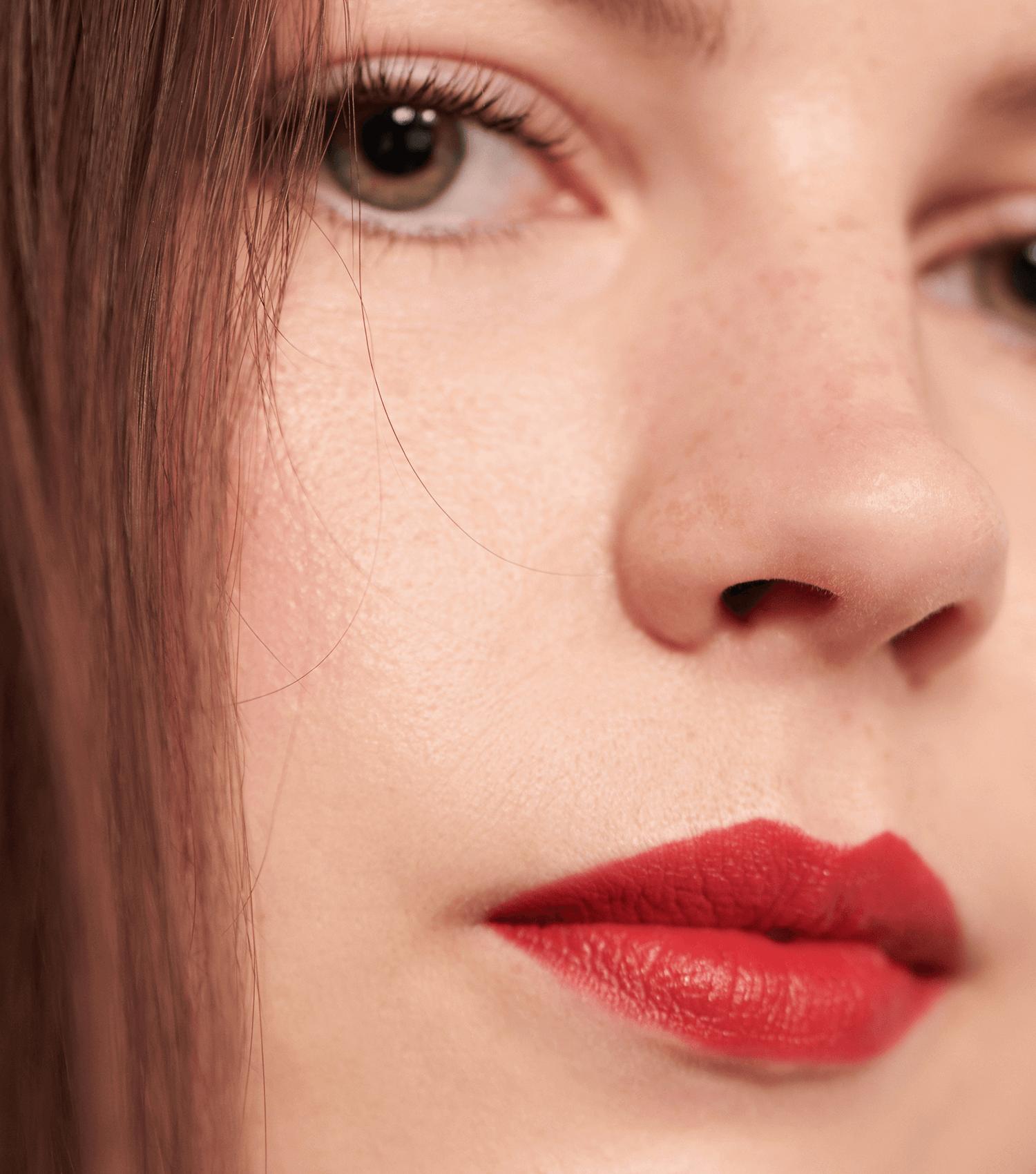Model wearing red lipstick