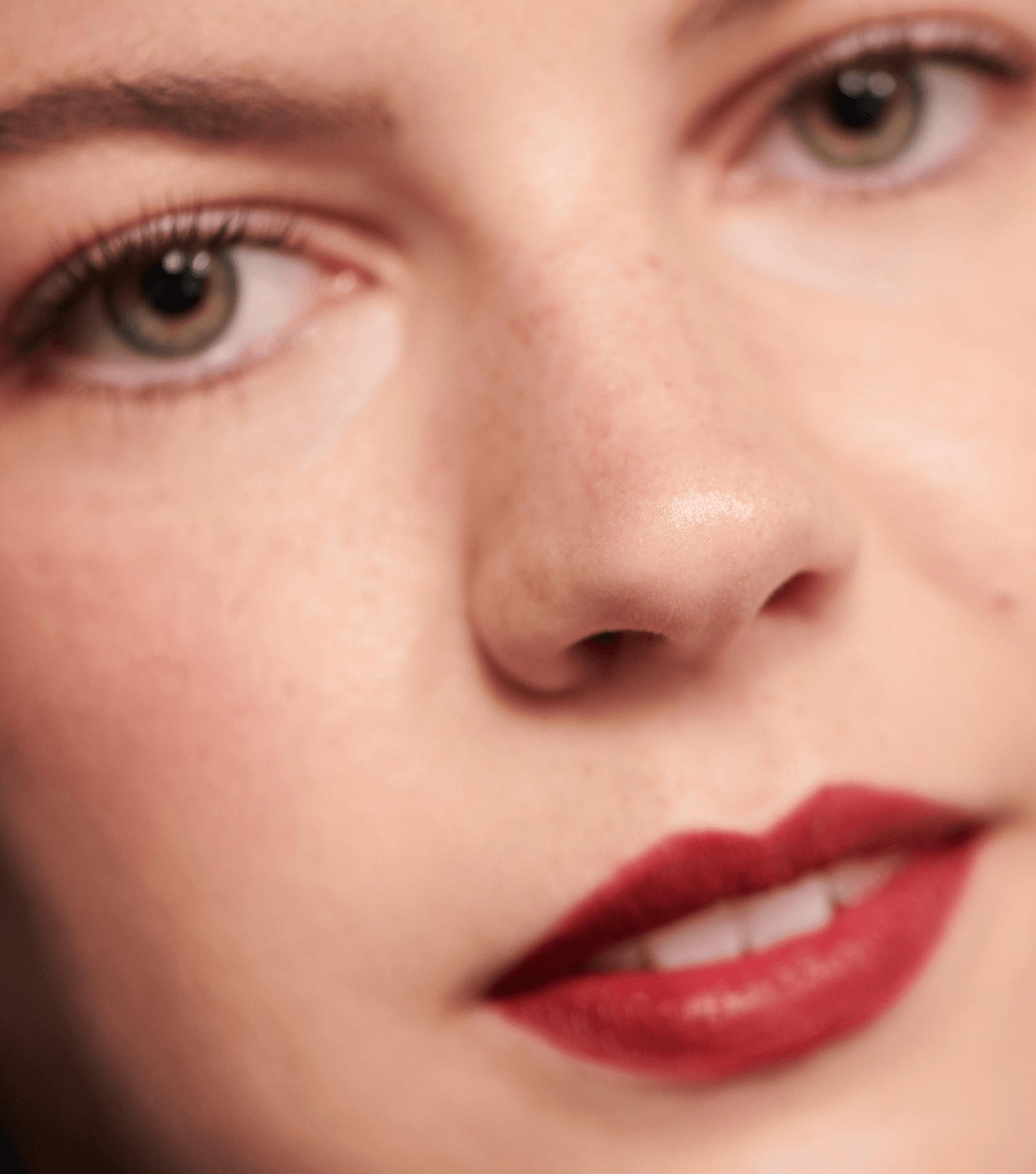 Model wearing dark red lipstick