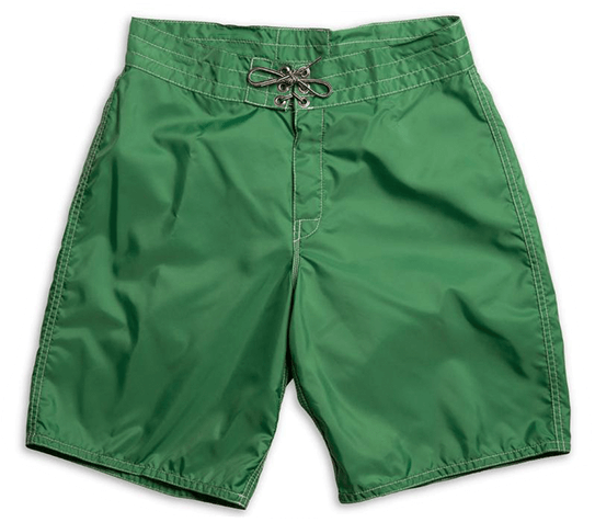 Green men's boardhshorts with white stitching