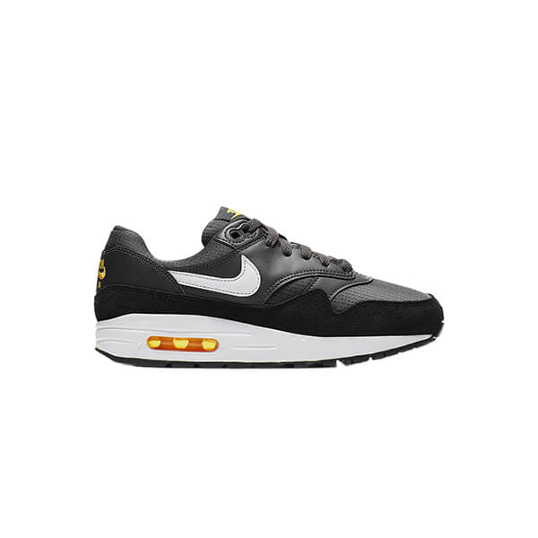Black and white nike sneakers with a little yellow detailing