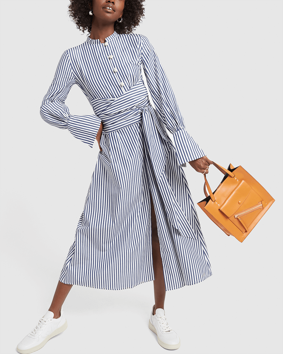 striped shirt dress, white sneakers, brown tote on figure