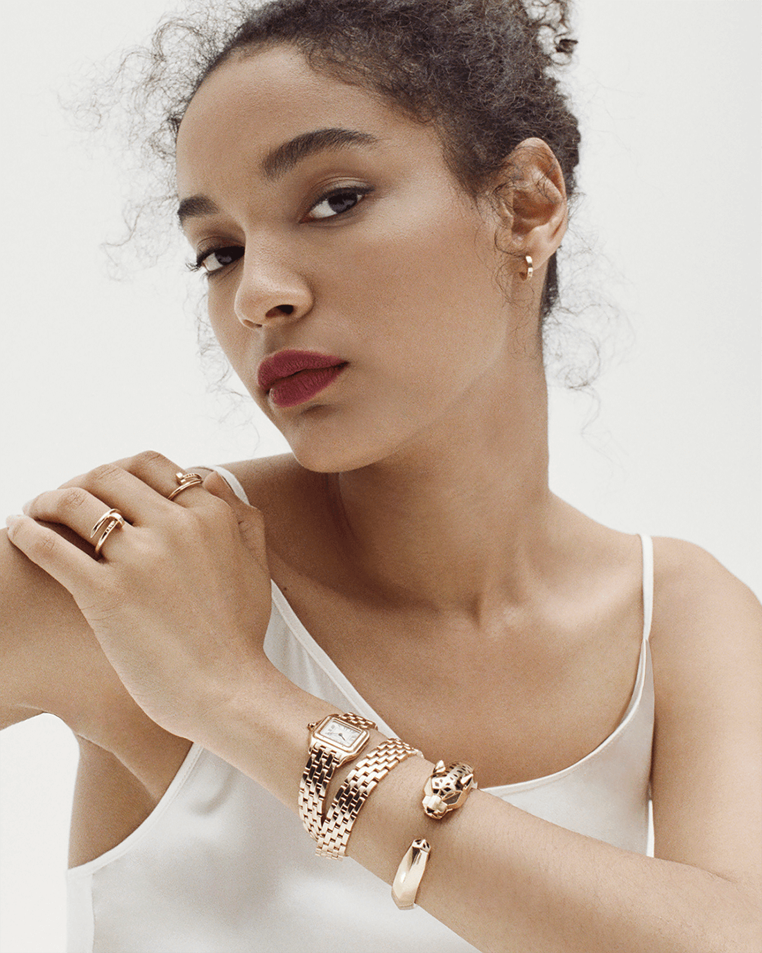 woman in datura dress, JUSTE UN CLOU RING YELLOW GOLD, PANTHÈRE DE CARTIER BRACELET YELLOW GOLD, single LOVE EARRING YELLOW GOLD, JUSTE UN CLOU RING YELLOW GOLD and PANTHÈRE DE CARTIER WATCH YELLOW GOLD