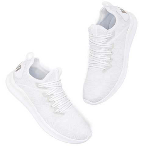 White running sneakers with PUMA on heel