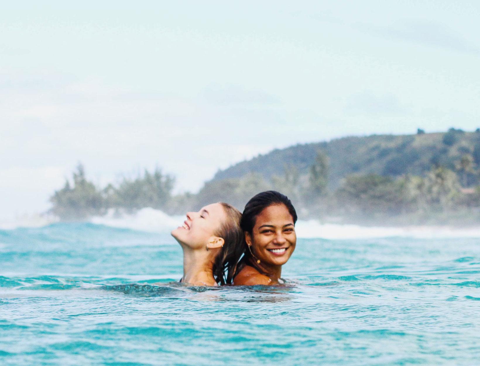 women swimming in the ocean