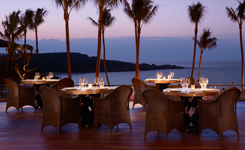 beachside dining setting at night