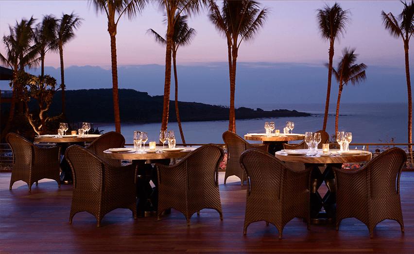 beachside dining setting at night
