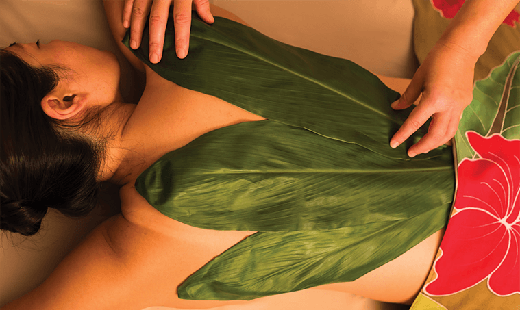 woman with banana leaves on her back