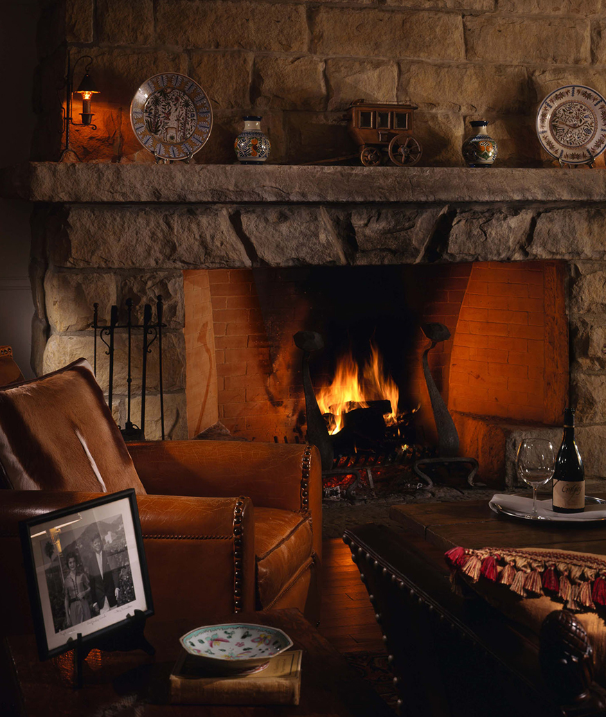 leather armchair by fire