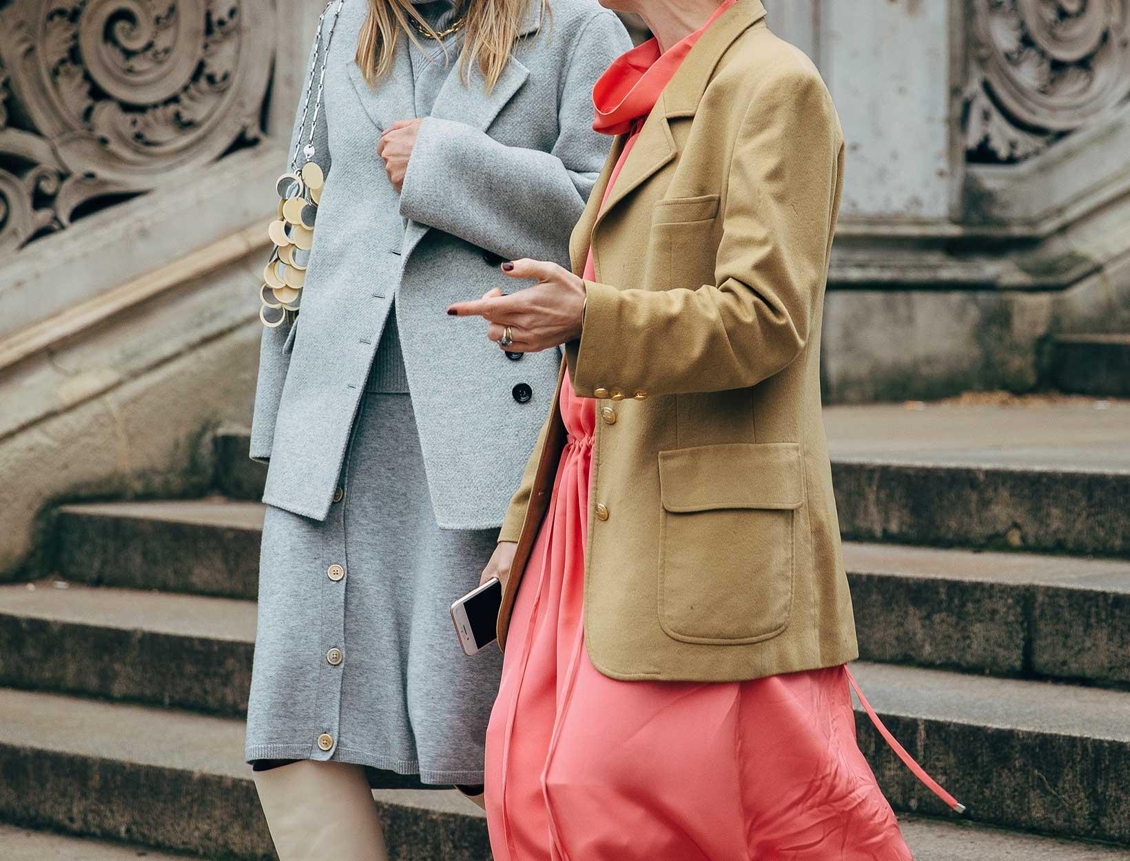 women wearing oversized coats
