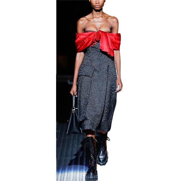 Runway model in red and herringbone dress