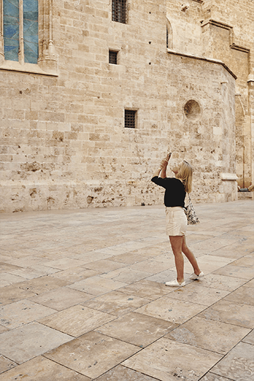 woman taking picture of buildings