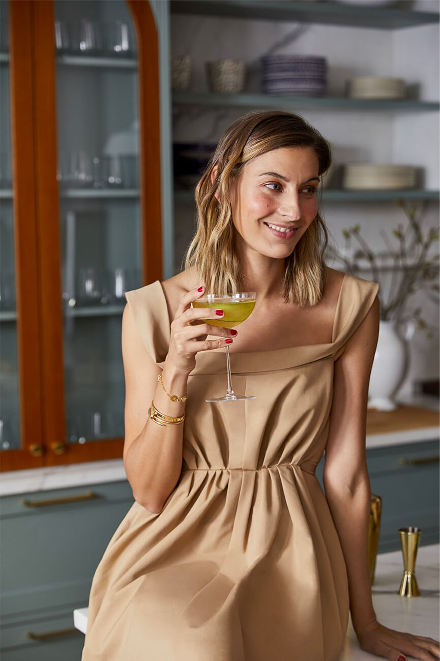 woman holding a drink