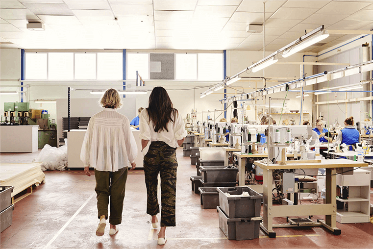 people walking through a factory