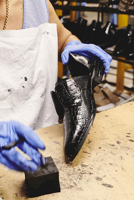 man shining shoes
