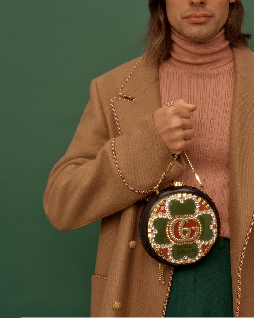Model holding Gucci bag