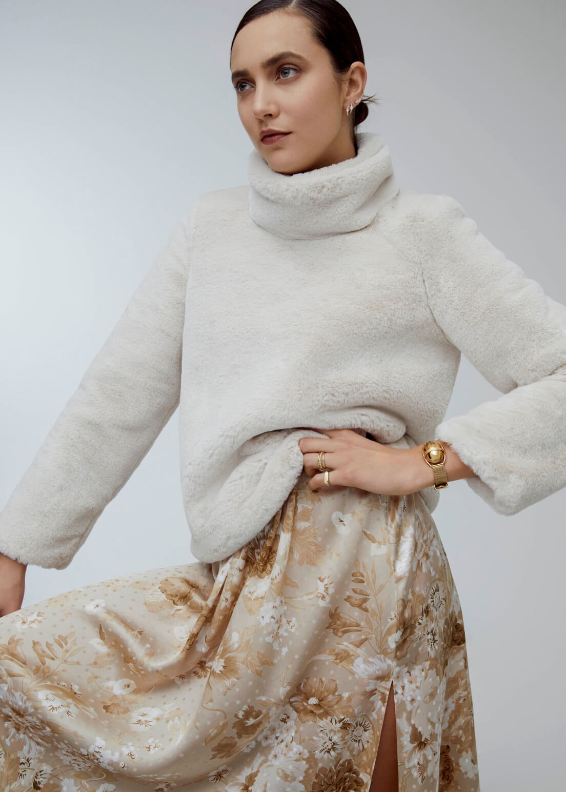 woman posing with a sweater and skirt