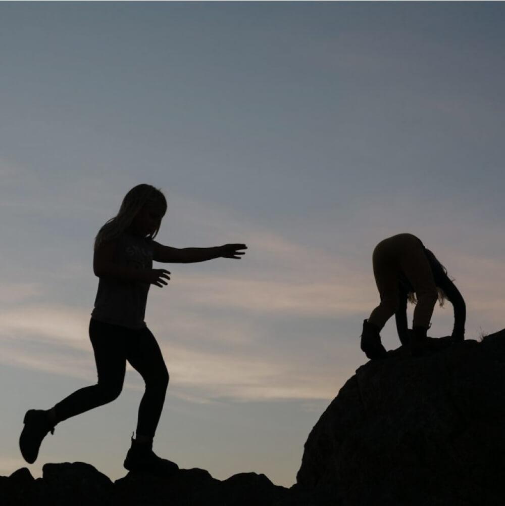 children climbing rocks