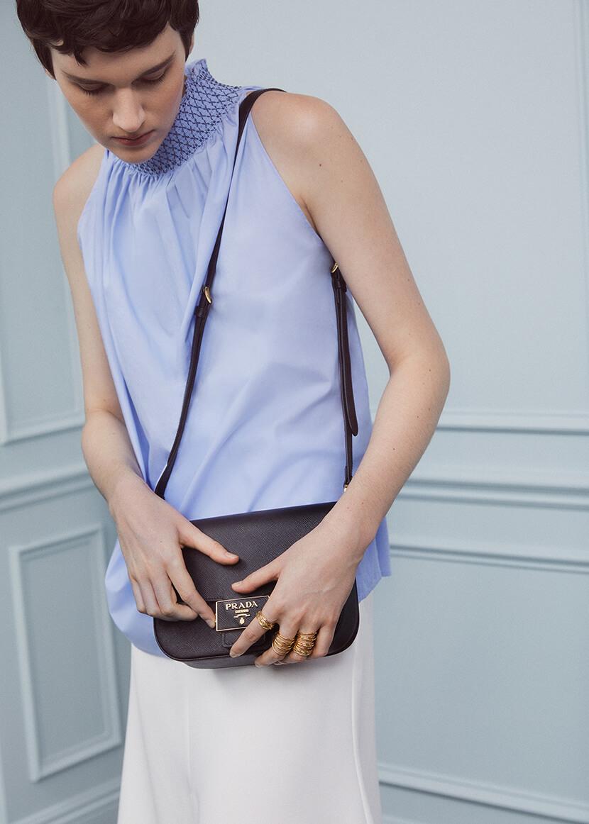 Woman with Prada bag