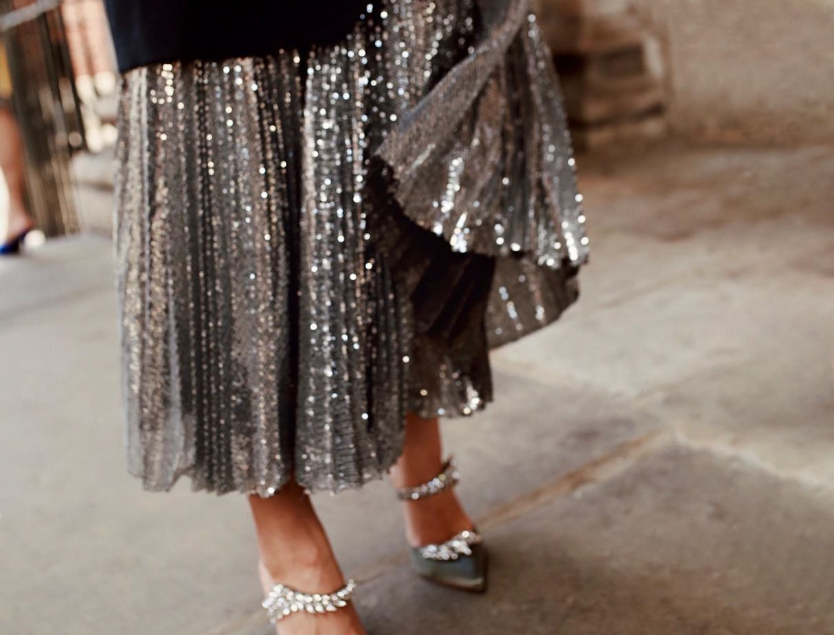 woman in sequin skirt