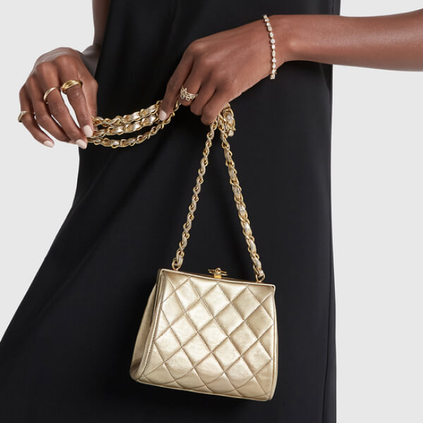 What Goes Around Comes Around chanel bag and Thira strapless dress