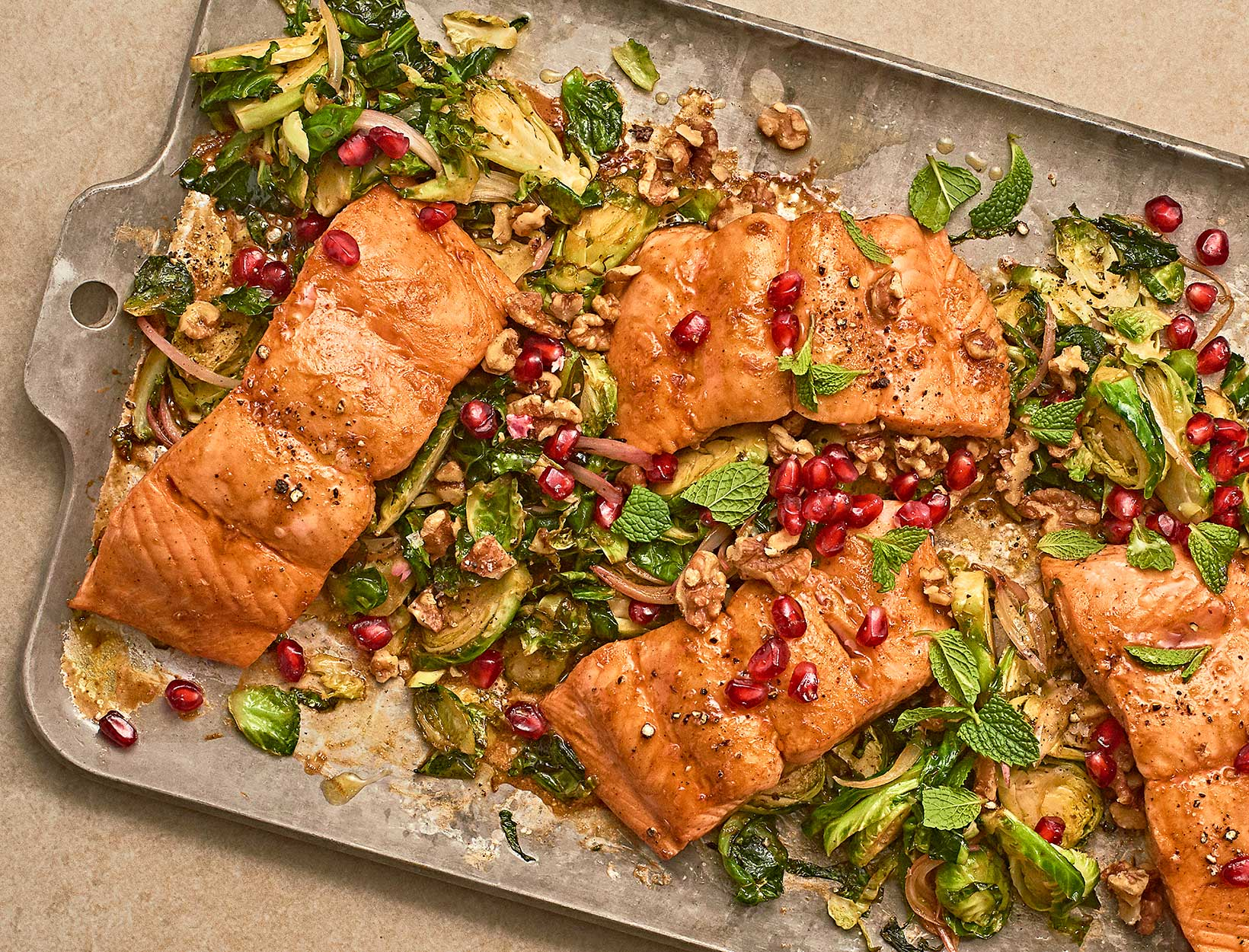 Sheet-Pan Salmon with Shaved Brussels Sprouts, Pomegranate, Walnuts, and Mint