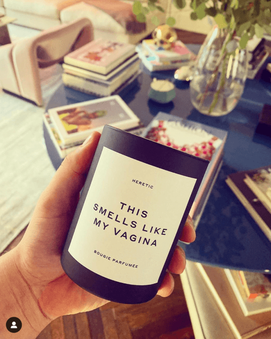 hand holding vagina candle