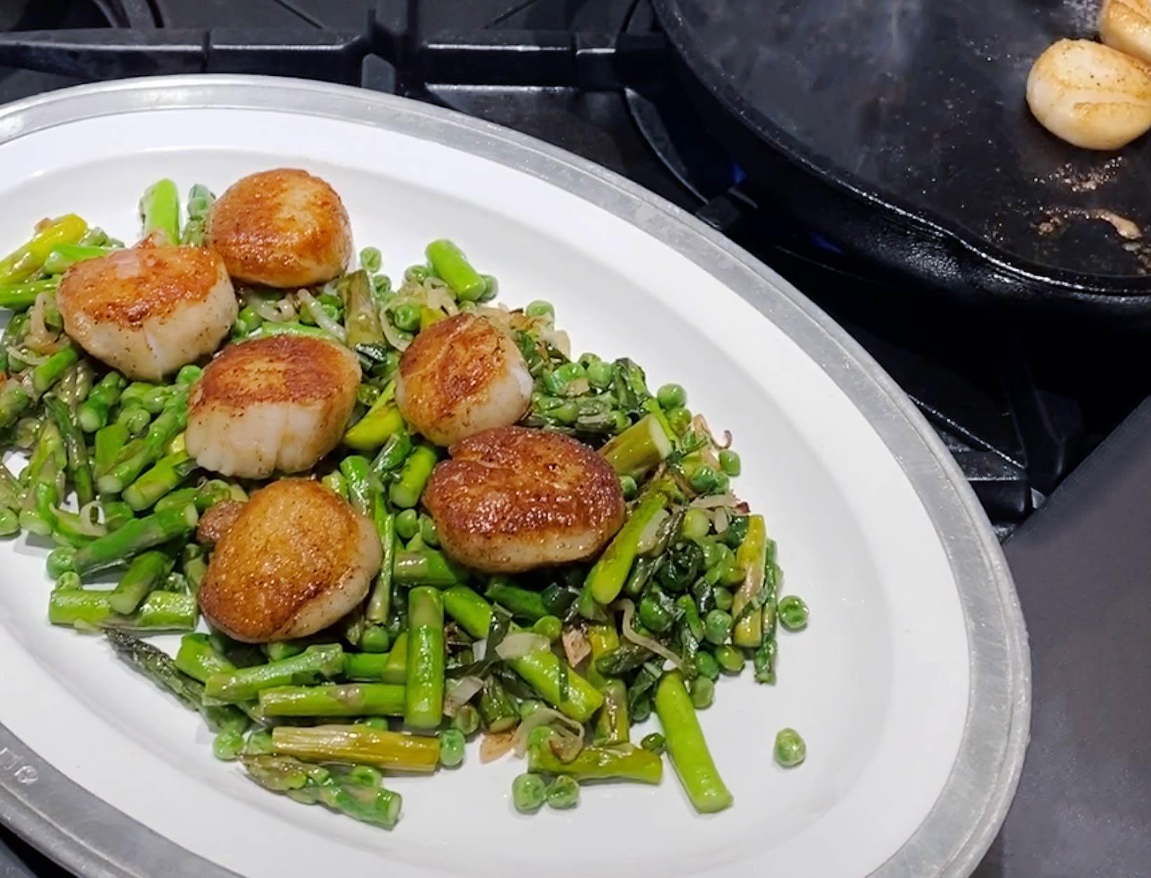 Seared Sea Scallops over Sautéed Asparagus and Peas Recipe | Goop