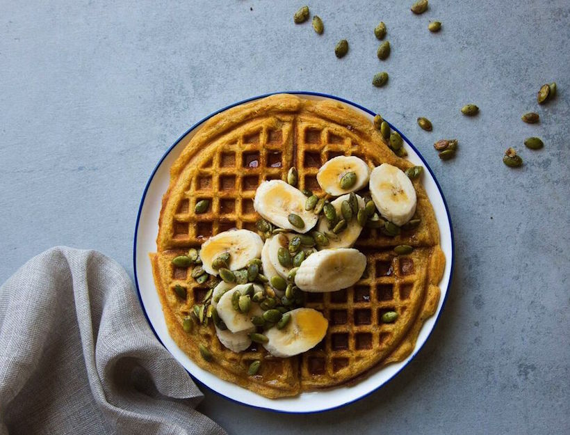 Gluten-Free Pumpkin Waffles with Banana & Candied Pumpkin Seeds