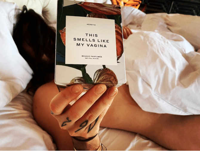 woman in bed with vagina candle