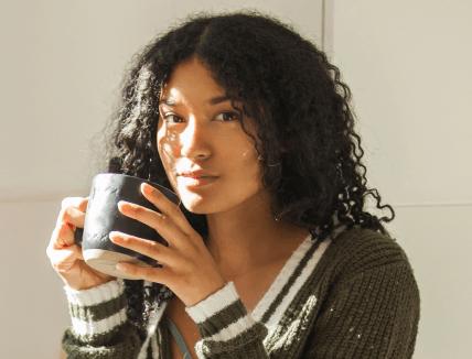woman drinking from mug