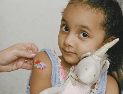 young girl with bandaid
