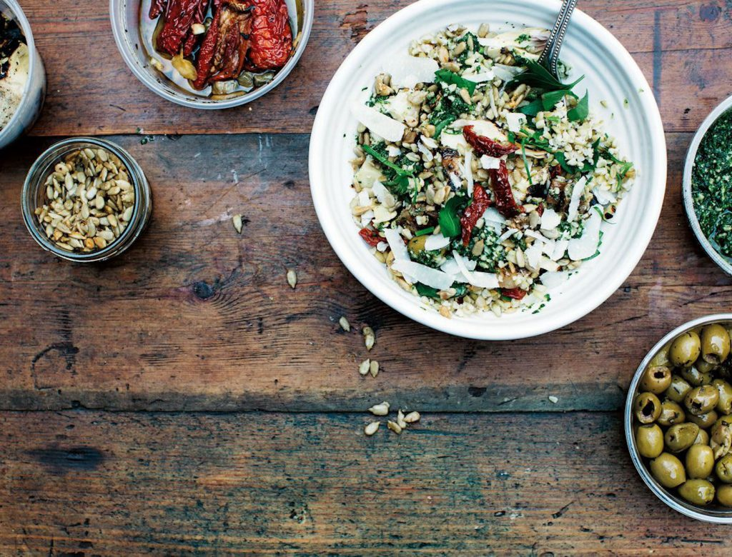 Freekeh with Deli Vegetables, Kale Pesto, and Chili-Parmesan Sunflower Seeds