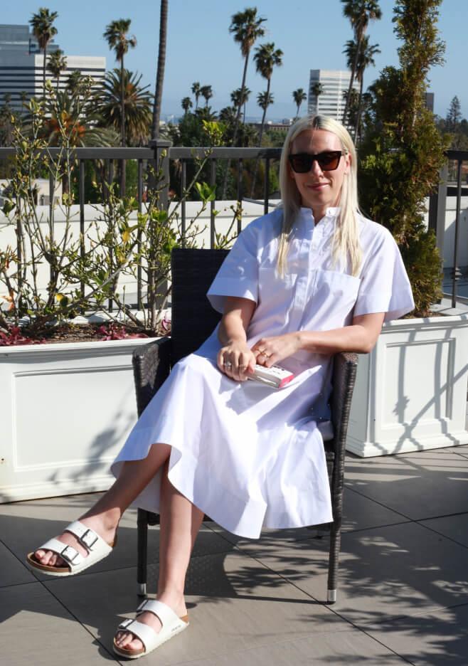 ali pew sitting on a patio