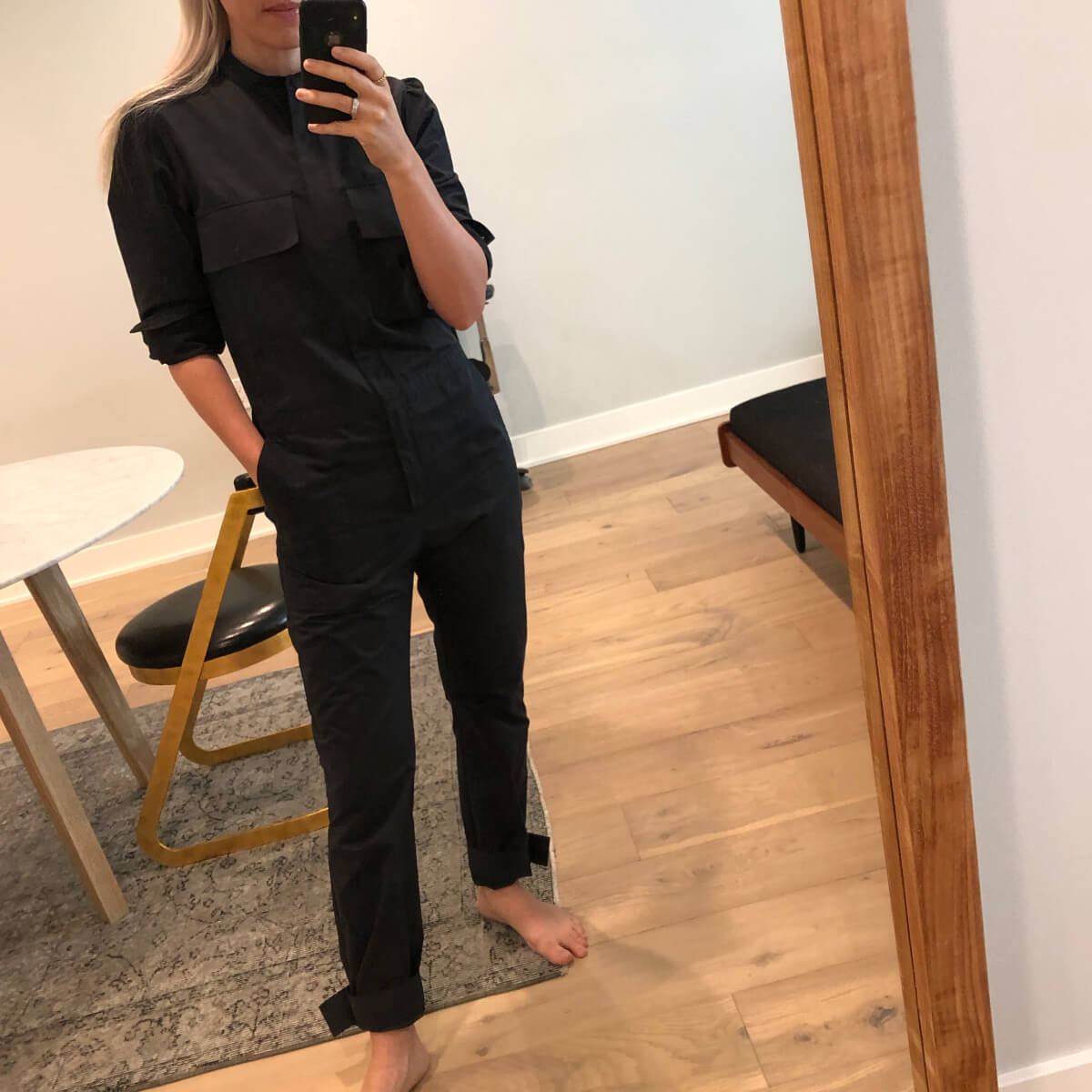 ali pew wearing a jumpsuit