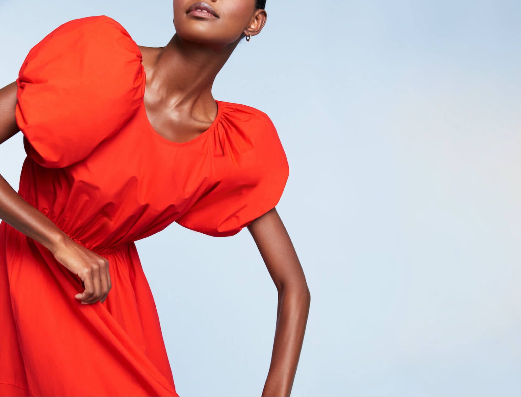 woman in orange dress posing