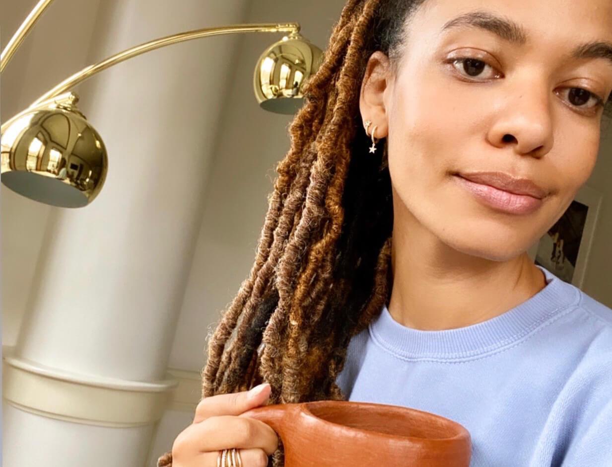 AURORA JAMES holding mug