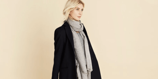 Woman wearing blazer and scarf