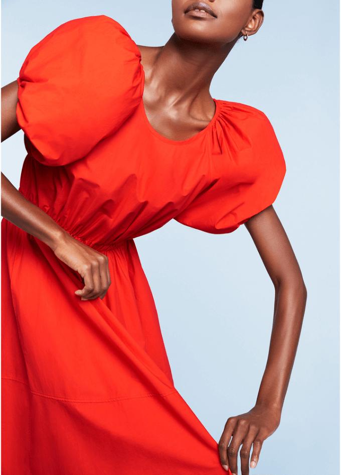 model wearing orange dress