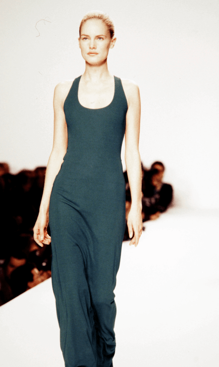 model on runway in teal dress