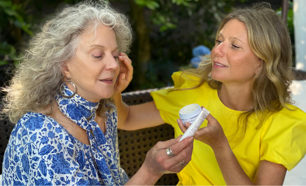 GP applying goopgenes all-in-one nourishing face cream to Blythe Danner
