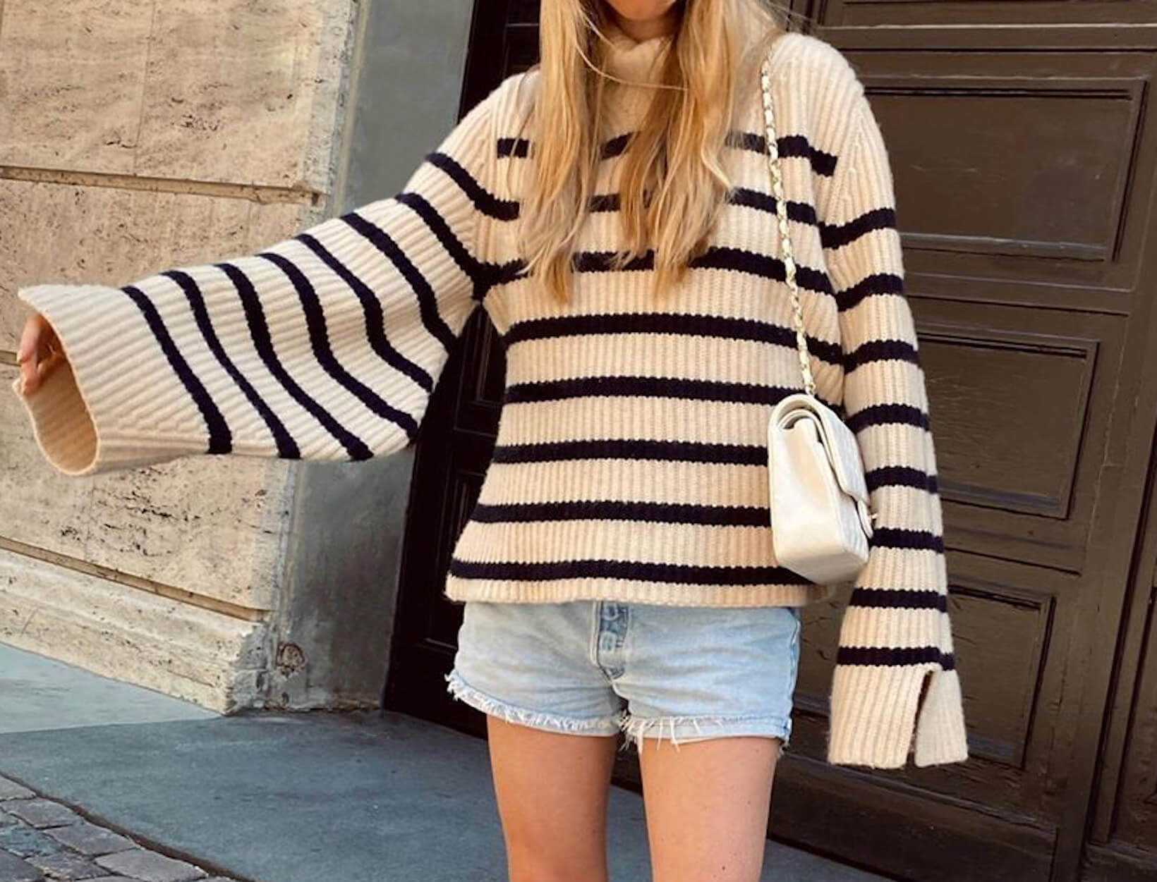 woman in sweater and shorts